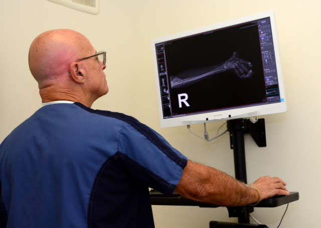 Dr. Caplan looking at an x-ray image on a monitor