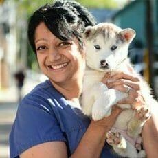 Marianna Pinto holding a puppy